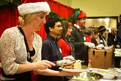 Photo Credit: COURTESY OF POTLUCK IN THE PARK - Potluck in the Park volunteers (shown here in 2012) expect to serve about 1,500 Christmas Day meals Thursday as part of its annual holiday dinner. This year's dinner is in the Portland Art Museum's sunken ballroom.
