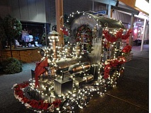 Photo Credit: BARBARA SHERMAN - This locomotive decorated for the holidays is one of the features that makes McCann's Pharmacy a focal point of the King City Plaza.