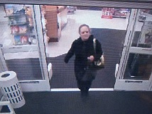Photo Credit: COURTESY OF SHERWOOD POLICE DEPARTMENT - Here's the woman police suspect removed a purse from the shopping cart of a 43-year-old disabled Sherwood woman on Christmas Eve.