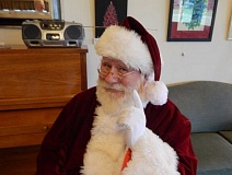 Photo Credit: BARBARA SHERMAN - Santa Claus (aka Don Waddell) takes a brief break fron the North Pole to stop by the King City Clubhouse in December.