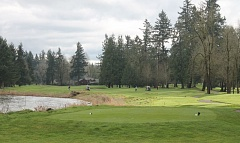 Photo Credit: JIM BESEDA/MOLALLA PIONEER - The view from the tee box of Arrowhead Golf Club's signature hole -- the 505-yard, par-5 18th along the Molalla River.