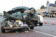 Photo Credit: HOLLY M. GILL - A semitruck rear-ended a car on U.S. Highway 97, south of Madras, on Dec. 24, injuring four people.