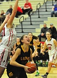 Photo Credit: MATTHEW SHERMAN - Daria Ruediger goes up for a shot against pressure from Oregon City in West Linn's overtime victory against the Pioneers. The Lions would advance to the semifinals of the Nike Interstate Shootout with a win over West Albany.