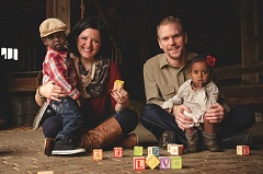 Photo Credit: PHOTO BY SAMANTHA IRELAND   - Anna Ahrens introduces Jayce to playing with blocks, while her husband, Philip, interacts with Anya.