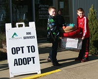 Photo Credit: PHOTO BY CINDY FREE-FETTY - Jake Brady, left, and Jaiden Fetty bring donated beds and other assorted goodies to the shelter dogs at Clackamas County Dog Services.