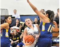 Photo Credit: GARY ALLEN - Road block - Remy Brentano fights through contact on her way to the lane during St. Paul's 51-28 victory over Gervais Friday. Brentano scored seven points for the No. 4-ranked Bucks.