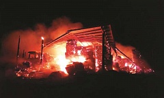 Photo Credit: HOLLY M. GILL - A shed and its contents - 280 tons of hay, three tractors, a baler and a truck - were a complete loss after a fire late Sunday night on Quaale Road, about 13 miles northeast of Madras.