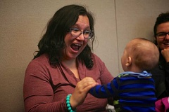 Photo Credit: CONNECTION PHOTO: KELSEY OHALLORAN - Arianna Prieta dances with five-month-old Julius Prieta as they hear Where the Wild Things Are read at Capitol Hill Library. The library will host a toddler storytime on Friday.