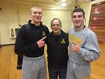 West Linn's Jacob Taylor and Tim Harman stand with coach Doug Samarron after each winning their brackets at the competitive Pac Coast Championships. West Linn took sixth as a team in the tournament.