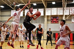Photo Credit: JAIME VALDEZ - Briggs Young goes on the attack in Oregon Citys 59-57 win at Clackamas. Young had a career night in a Jan. 6 game at Reynolds, scoring a career-high 33 points in a 54-51 Pioneer victory.