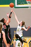 Photo Credit: JAIME VALDEZ - Putnam sophomore post Haley Brandel (33) blocks a shot by Central 6-1 senior Sai Tapasa (22) during an early preseason game with the Panthers. Brandel was in form last Friday, rejecting a school-record 10 shots in a 49-38 win over Parkrose.