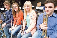 Photo Credit: KEVIN SPERL - Crook County High School students, from right, Kyle Bates, Haley Hedenstrom, Abigail Papke, and Connor Chaney took part in last week's COMEA honor band concert at Bend High School.