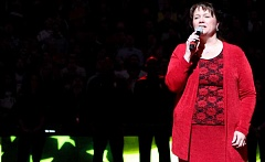 Photo Credit: PHOTO COURTESY DAVID BLAIR OF THE PORTLAND TRIBUNE - Prineville resident Mary Chapman belts out the Star Spangled Banner Saturday evening at the Moda Center, just before the Portland Trail Blazers played. The approxmately 20,000-person crowd is the largest she has ever sang to.