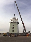 Photo Credit: SUBMITTED - This image shows a crane placing the top part of the tower onto the structure at Aurora State Airport late in 2014.