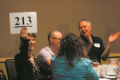 Photo Credit: FILE PHOTO - The North Marion Auction will continue the silent and oral auction as usual, the latter of which is pictured here from last year's event, but this year will also include an online auction.