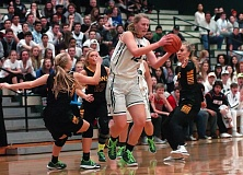Photo Credit: DAN BROOD - Tigard junior post Elise Conroy stands tall among a trio of West Linn defenders in Friday's game.