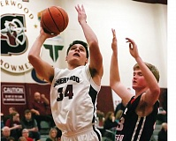 Photo Credit: DAN BROOD - IN THE POST -- Sherwood sophomore post Luka Nixon (34) had a big game for the Bowmen with 18 points and six rebounds on Tuesday.