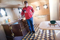 Photo Credit: KEVIN SPERL - Monty Klaus stands inside one of his two showcase vintage campers.