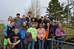 Photo Credit: MARK MILLER - Students volunteering at St. Helens Middle School for a 'Day of Service' Monday, Jan. 19, pose during a break in their work. Volunteers raked leaves, picked up trash and improved trails, among other chores, on the school grounds.
