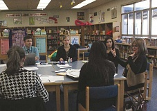 Photo Credit: TYLER FRANCKE | WOODBURN INDEPENDENT - Maureen T. Casey, far right, executive director of the Fostering Hope Initiative, leads a meeting of the Washington FHI Design Team in the library of Washington Elementary School last week. The team meets monthly to discuss and plan upcoming events and projects.