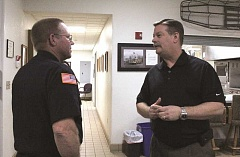 Photo Credit: LINDSAY KEEFER - Hubbard Fire District's new interim chief Ted Kunze (right) meets volunteer firefighter Mike Blalock during a meet-and-greet before the district's board meeting Wednesday.