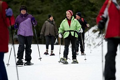 Photo Credit: POST PHOTO: TROY WAYRYNEN - Janelle Wellman, left, director of business development at the American Heart Association, and Patti Hallgren, of Welches, enjoy conversation while snowshoeing along the Trillium Lake Trail Thursday Jan. 15. Hallgren started snowshoeing with friends on her birthday 10 years ago to stay heart healthy in honor of her mother, who died of a heart attack.