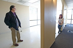 Photo Credit: OUTLOOK PHOTOS: TROY WAYRYNEN - Stephen Salaz, left, owner of Mt. Hood Chiropractic Clinic, and office manager Rayna Adams, look over new office space Thursday, Jan. 8, in Troutdale.