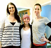 Photo Credit: SUBMITTED PHOTO - Helping hand -- Michelle's Love volunteer Kara Ranger (left) and founder Andy McCandless (right) came with a group to assist Newberg resident Kelly Slepicka (center) as she undergoes treatment for cancer.