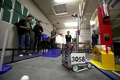 Photo Credit: TIMES PHOTO: JONATHAN HOUSE - Tigard High students from left, Zack Carter, Ryan Fitzpatrick and Ethan Gazin pilot their robot Critical Mass before this weekends league robotics championships.