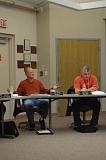 Photo Credit: COURTNEY VAUGHN - Columbia River PUD President, Dave Baker, left, voices frustration to fellow board members over a suggestion to hire a new fill-in attorney. The board voted narrowly to replace the interim attorney it hired about a month ago.