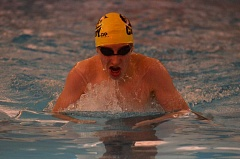 Photo Credit: HERALD PHOTO: COREY BUCHANAN - Canby swimmer Jarod Spencer swimming in the 100-meter breaststroke against Lake Oswego.