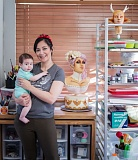 Photo Credit: TIMES PHOTO: JONATHAN HOUSE - Artisan Cake Company owner Liz Marek poses with her daughter Avalon and her cakes in her Beaverton kitchen.