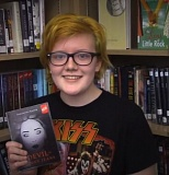 Photo Credit: PHOTO COURTESY: SHAMROCK NEWS/ROWE MIDDLE SCHOOL - Rowe Middle School eighth-grader Samantha Haack with her novella 'The Devil in Skinny Jeans.'