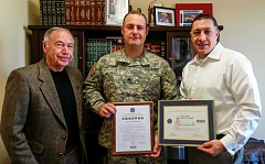 Photo Credit: SUBMITTED PHOTO - Tyler Smith, right, was nominated by employee and National Guard NCO James Adams, center, for the Patriot Award, which was presented by retired Gen. Dan Hitchcock.