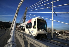 Photo Credit: TRIBUNE PHOTO: JONATHAN HOUSE - A MAX train goes over the Tilikum Crossing under its own power for the first time last Wednesday morning.