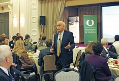Photo Credit: COURTESY: PORTLAND BUSINESS ALLIANCE - Economist John Mitchell tells Portland Business Alliance members that the states economy is definitely improving.