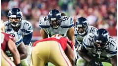 Photo Credit: COURTESY OF MICHAEL WORKMAN - Will Tukuafu (46) lines up behind Seattle Seahawks quarterback Russell Wilson (3) and in front of running back Christine Michael (33) in a game against San Francisco.