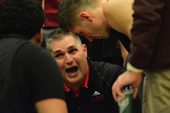 Photo Credit: THE OUTLOOK: DAVID BALL - Mt. Hood CC coach Geoff Gibor communicates a plan during a timeout in the final minute Wednesday night.