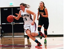 Photo Credit: DAN BROOD - ON THE GO -- Tualatin High School junior Emily Leonard heads up court on a fast break during Friday's Three Rivers League contest with West Linn. The Lions scored a 45-39 victory.