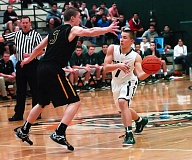 Photo Credit: DAN BROOD - Tigard sophomore guard Luke Smith (right) looks pass the ball past West Linn's Payton Pritchard during Tuesday's game.