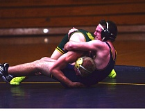 Photo Credit: HERALD PHOTO: COREY BUCHANAN - Zane Rise competing in the 170-pound weight class against West Linn.