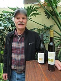 Photo Credit: PHOTO BY ELLEN SPITALERI - Burt Mostul, co-owner of Villa Catalana Cellars, shows off his two prize-winning wines.