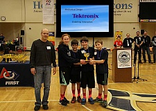 Photo Credit: SUBMITTED PHOTO - Wilsonville's Team STEAM won a second-place trophy for mechanical design in a Lego robotics state tournament Jan. 18.