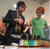Photo Credit: JOSEPH GALLIVAN - Drink me: Wylie Bettinger (R) serves samples of Wylies Honey Brews at a celebration of new community public offerings at Hatch Community Innovation Lab on Jan. 25 in Portland.