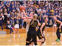Photo Credit: HERALD PHOTO: COREY BUCHANAN - Taylor Jorgensen led Canby with 18 points against West Linn.