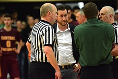 Photo Credit: THE OUTLOOK: DAVID BALL - Game officials meet with both coaches to explain the sequence of events in a wild finish Friday.