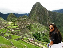 Photo Credit: SUBMITTED PHOTO - During her time in Peru, Ari Archibald was able to visit some famous historic locations. Here, she sits atop the ruins at Machu Piccu, a fifteenth-century Inca village.