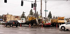 Photo Credit: RAY HUGHEY - Crews are busy working on intersection improvements slated for three Canby intersections along Highway 99E.