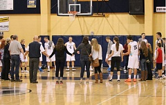 Photo Credit: JIM BESEDA/MOLALLA PIONEER - Country Christian's players, coaches, friends and others share fellowship after a recent Cougars' home game.