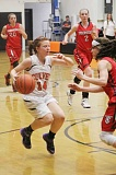 Photo Credit: JEFF WILSON/THE PIONEER - The Bulldogs' Margie Beeler drives into the lane against Weston-McEwen Friday night.